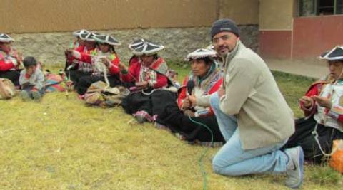 Alberto Vasquez interviews women in Pitumarca, Peru