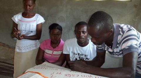Four villagers at the cassava training workshop