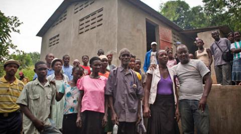 Villagers outside cassava factory in Gens de Nantes