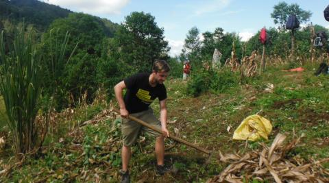 ICS volunteer Edward Maddocks digging a farm field