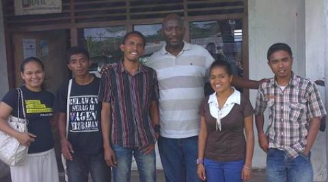 David Muganga (centre, fourth from the left) with FONGTIL youth members