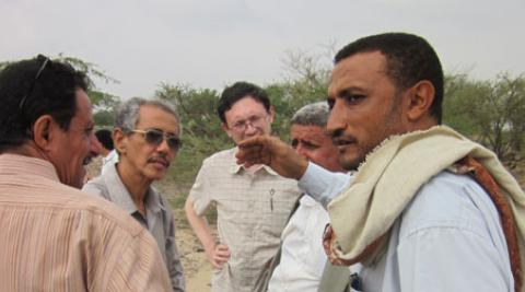 Derek Kim (centre) meets with local farmers in Wadi Zabid