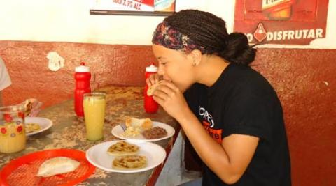 ICS volunteer Ingrid eating a pupusa