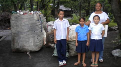 Children in El Salvador with bag of plastic bottles