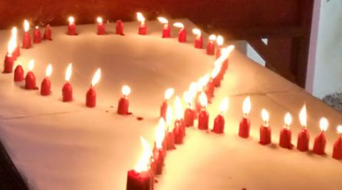 A display of candles at the Estrela+ Christmas party