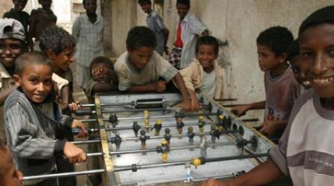Yemeni boys play table football. (Nick Sireau/Progressio)