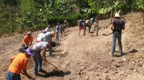 Volunteers working on hillside farm in Honduras