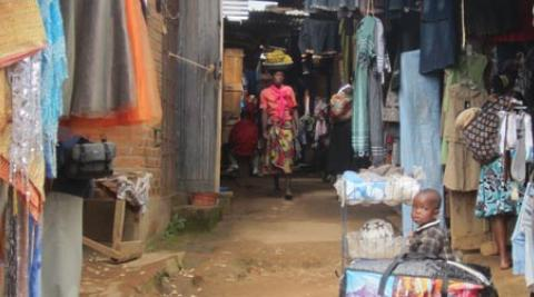 Woman and baby in clothes market