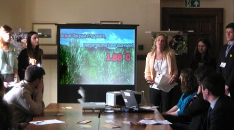 ICS volunteers doing a presentation in Parliament
