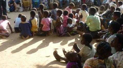 Women and children gathered for a talk in a village in Malawi