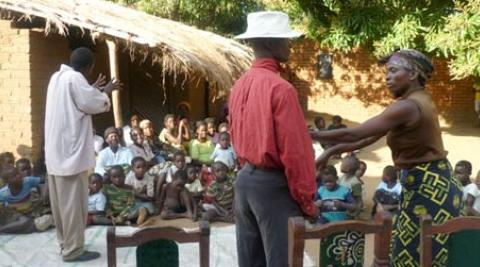Children in Malawi village watch drama about HIV