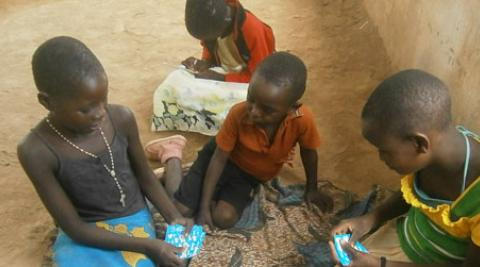 Kids in Malawi playing cards