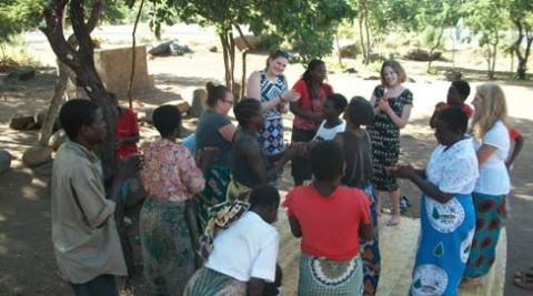 Singing and dancing whilst visiting the Women's HIV Support group