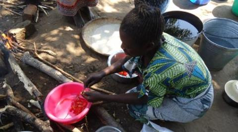 A woman preparing food in Malawi