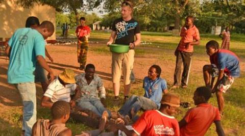 UK volunteer Michael with the bucket game