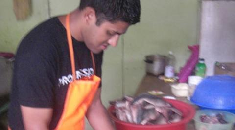 Monju Meah helping at a soup kitchen