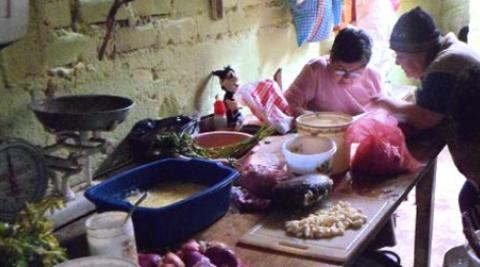Women preparing a meal at the 'comedor' in Villa El Salvador, Peru
