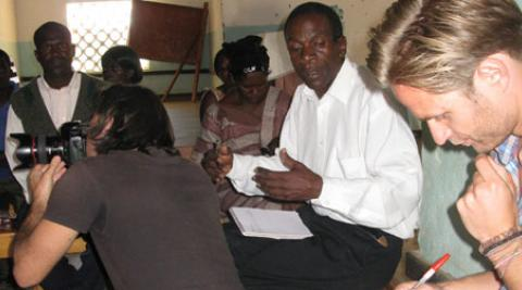 Photographer and journalist meeting HIV support group in Malawi