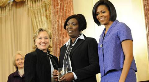 Sonia Pierre (centre) with Hillary Clinton and Michelle Obama