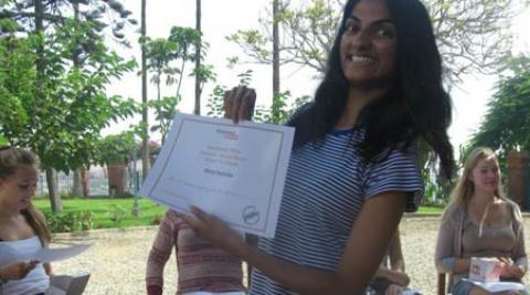 Progressio ICS volunteers hold certificates