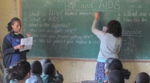 ICS Volunteers Yvonne and Charlee talking about HIV in a classroom in Zimbabwe