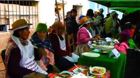 Women at a food fair in Huancavelica, Peru