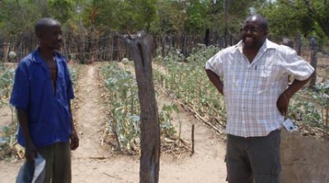 Development worker Cliff Maunze (right) with a farmer in Zimbabwe