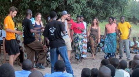 Volunteers and villagers dancing