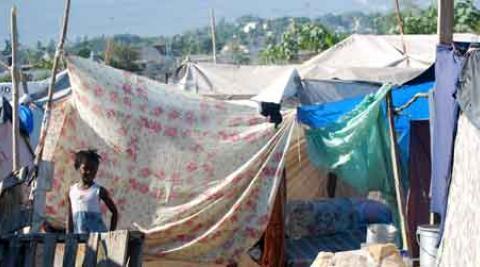Haitian women selling mangoes amid the rubble
