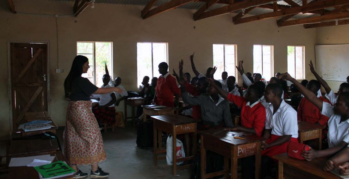 Tara eliciting answers from students at Edinburgh All-Girls School