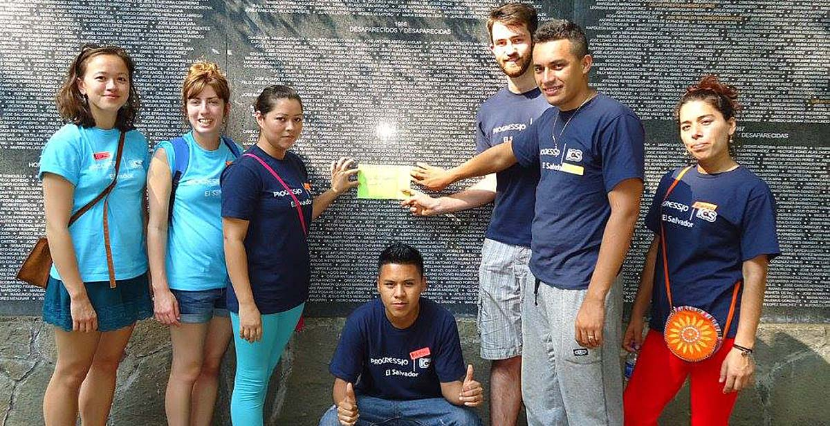 Tom with his team at the memorial plaque