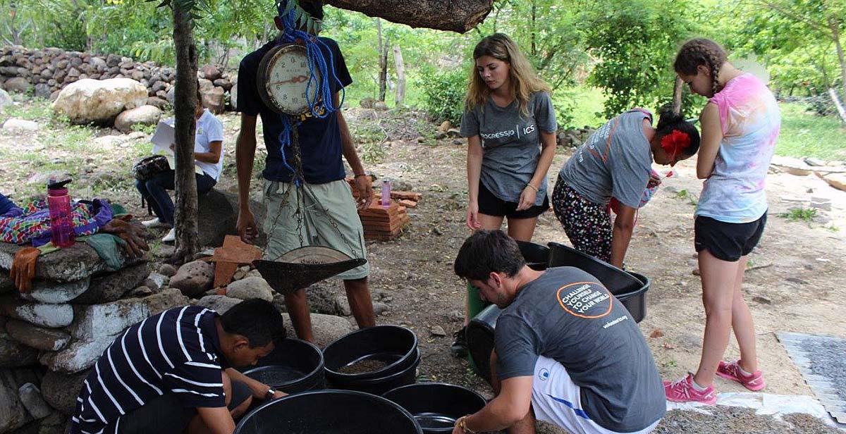 Volunteers building water filters