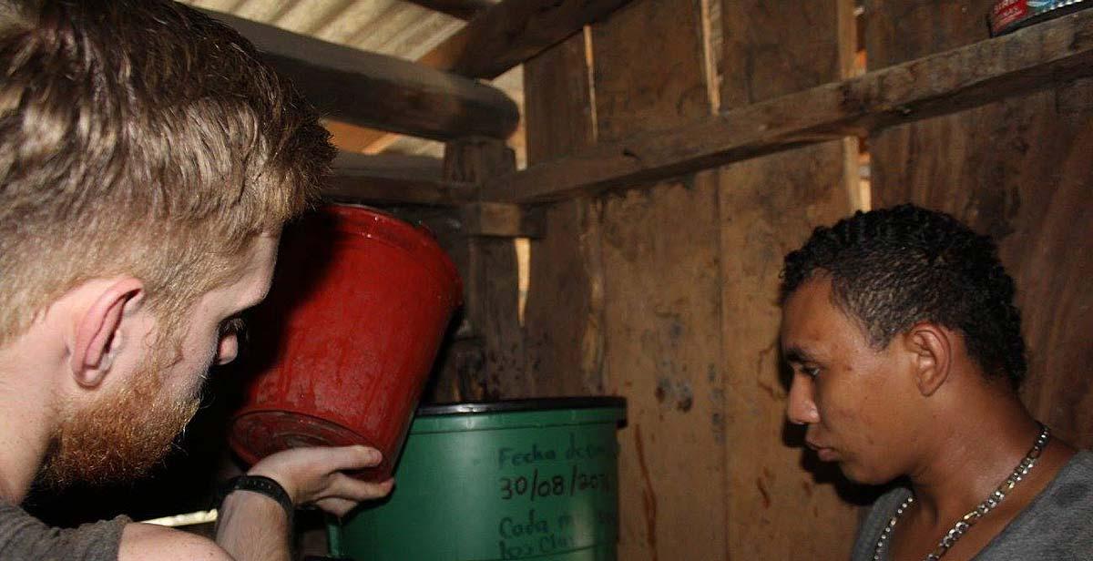 Volunteers installing a new water filter