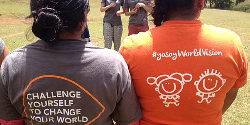 Volunteers showing their Progressio ICS and World Vision t-shirts