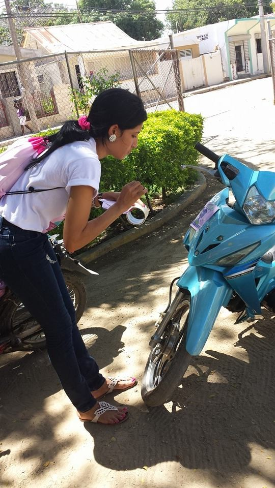 Yunelsi preparing her field visit with her motorbike