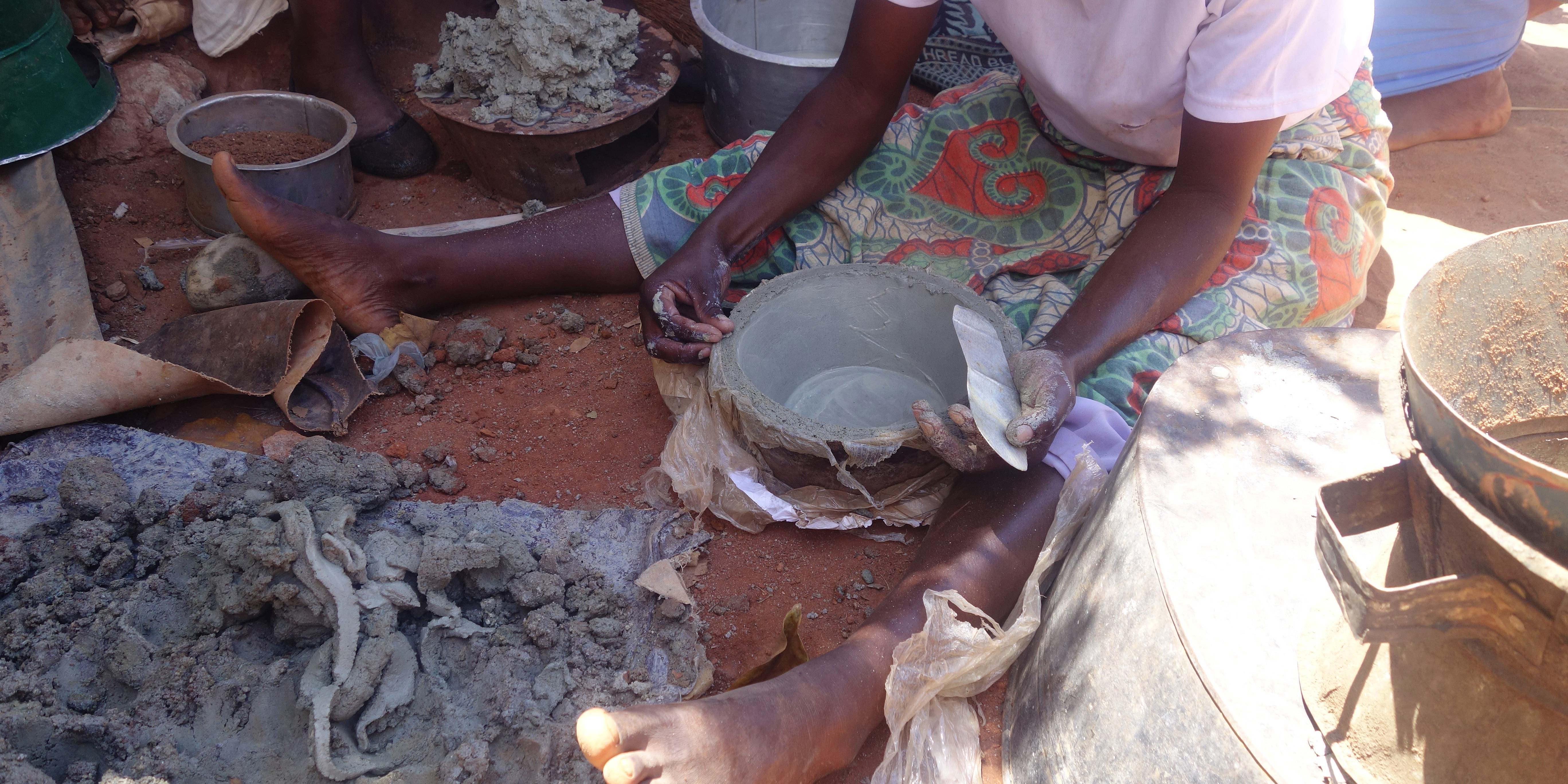 Visiting local women who make clay stoves